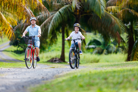 father and son: Family of father and son biking at tropical settings