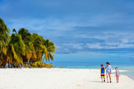 south pacific: Mother and kids family at tropical beach on Aitutaki island, Cook Islands, South Pacific Stock Photo