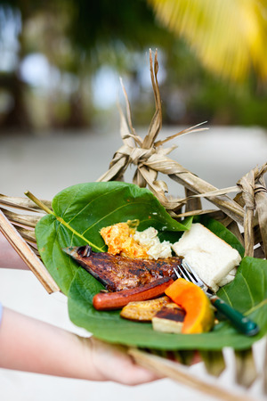 weaved: Close up of some local south pacific origin food on a weaved platter Stock Photo