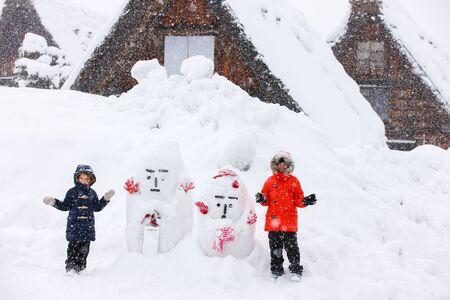 shirakawago: Tourist kids at historic Japanese village Shirakawa-go at winter, travel landmark of Japan