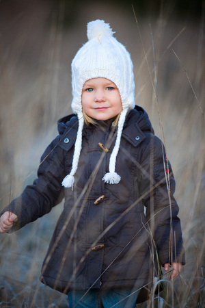 parka: Portrait of adorable little girl wearing parka outdoors on cold winter day