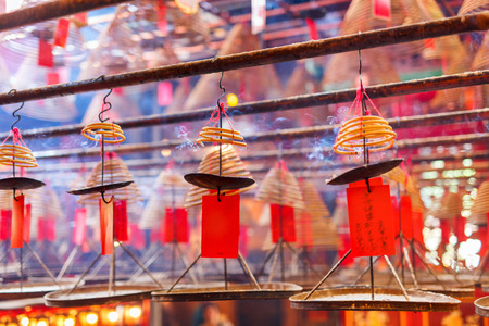 burning man: Circular incenses burning in Man Mo Temple, Hong Kong, China Stock Photo