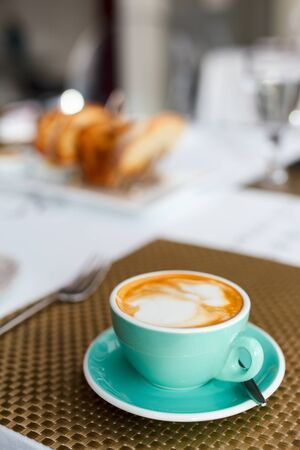 breakfast cup: Fresh coffee in turquoise cup served for breakfast