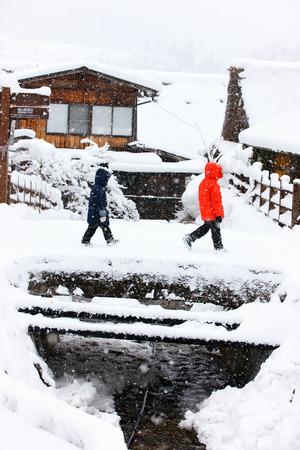 shirakawago: Kids at historic Japanese village Shirakawa-go at winter, travel landmark of Japan Stock Photo
