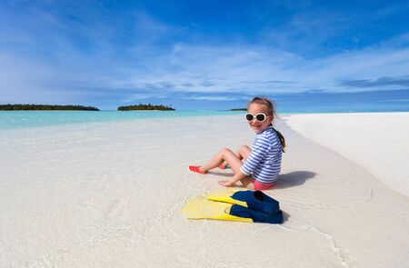 little girl beach: Adorable little girl with snorkeling equipment at beach during summer vacation