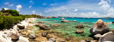 virgin islands: Panorama of a picture perfect beach with white sand, turquoise ocean water and blue sky at British Virgin Islands in Caribbean