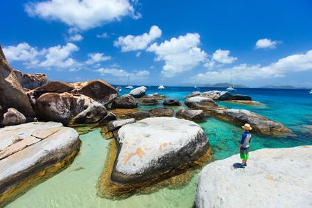 virgin islands: Little boy enjoying view of beautiful scenery of The Baths beach area major tourist attraction at Virgin Gorda, British Virgin Islands, Caribbean