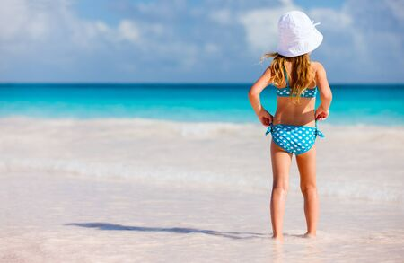 view girl: Back view of a little girl at beach during summer vacation Stock Photo