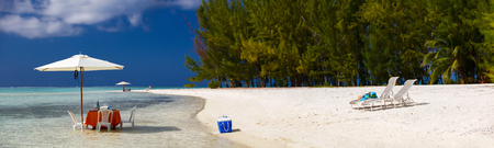water  panoramic: Panoramic photo of a tropical beach with picnic table set in a shallow water