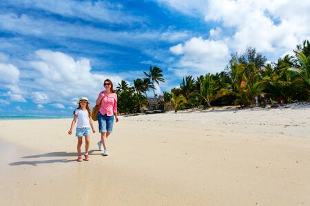 caribbean beach: Mother and daughter at tropical beach on exotic island Stock Photo