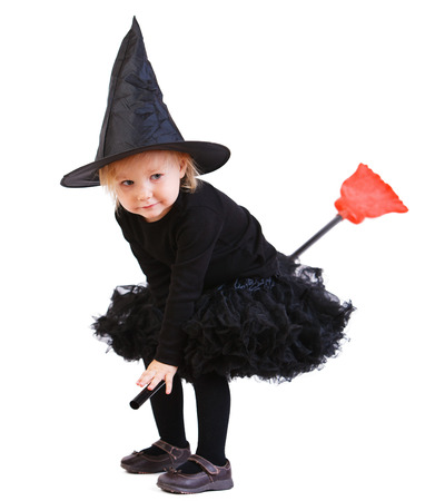 broomstick: Adorable little witch flying on broomstick isolated on white