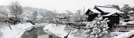 world village: Panorama of Takayama town from Nakabashi Bridge on winter day in Japan Stock Photo