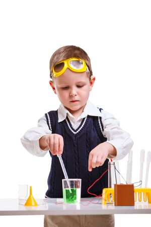 liquids: Young boy performing chemistry experiments with different liquids. Stock Photo