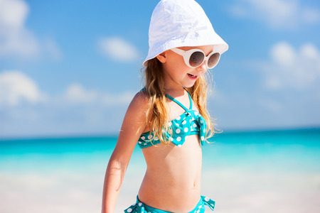 oceanfront: Adorable little girl at beach during summer vacation
