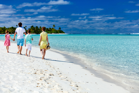 family vacations: Happy beautiful family on a tropical beach vacation