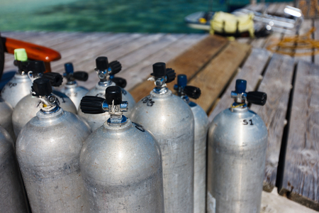 compressed air: Compressed air tanks prepared for diving trip