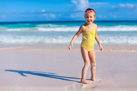 little girl swimsuit: Adorable little girl at beach during summer vacation