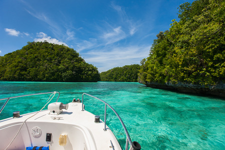 characterized: Exploring scenic lagoon of Palau is characterized by hundreds of limestone islands Stock Photo