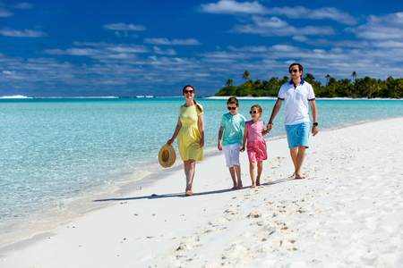 caribbean beach: Happy beautiful family on a tropical beach vacation