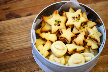 freshly baked homemade christmas cookies in a tin box wooden background stock photo 50288001 - Homemade Christmas Cookies