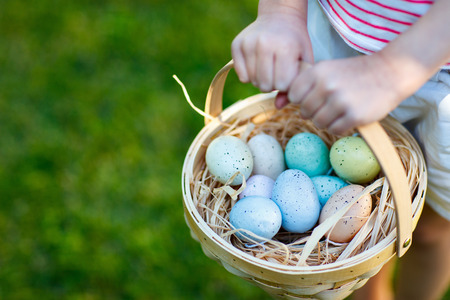 Close up of colorful Easter eggs in a basket 写真素材