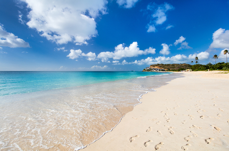darkwood: Idyllic tropical Darkwood beach at Antigua island in Caribbean with white sand, turquoise ocean water and blue sky