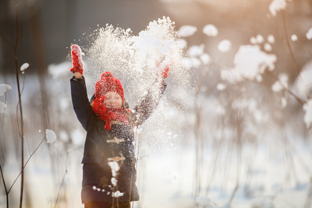 february: Adorable little girl wearing warm clothes outdoors on beautiful winter snow day Stock Photo