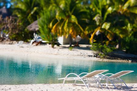 french polynesia: Beautiful beach with coconut palms on Bora Bora island in French Polynesia Stock Photo