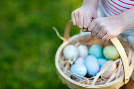 kids painted hands: Close up of colorful Easter eggs in a basket Stock Photo