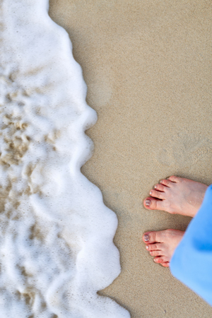 sandy feet: Close up of young woman feet on a tropical sandy beach