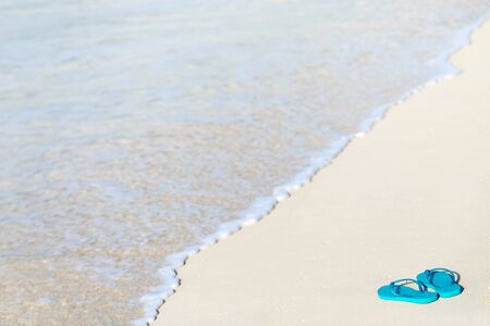 paradise bay: Turquoise flip flops on a tropical beach