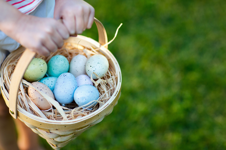 Close up of colorful Easter eggs in a basket Stock Photo
