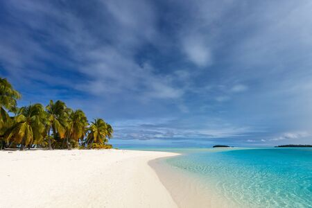 south pacific: Stunning tropical Aitutaki One Foot island with palm trees, white sand, turquoise ocean water and blue sky at Cook Islands, South Pacific