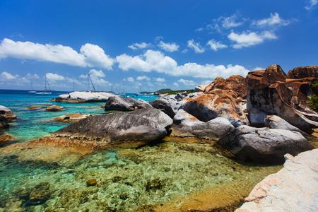 virgin islands: Stunning beach with white sand, unique huge granite boulders, turquoise ocean water and blue sky at Virgin Gorda, British Virgin Islands in Caribbean