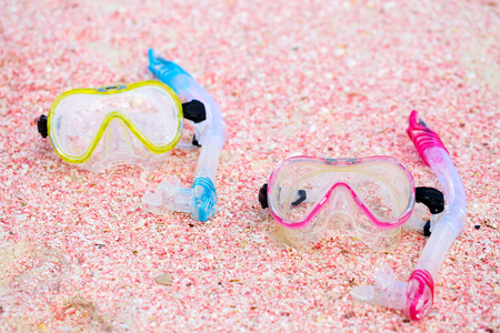 sports shell: Snorkeling equipment mask and snorkel on beach made of small pink shells