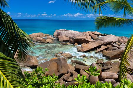unspoilt: Beautiful little secluded beach at tropical La Digue island in Seychelles