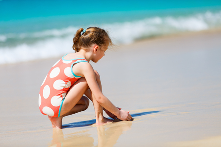 seaside: Adorable little girl at beach during summer vacation