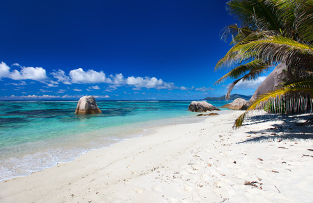 Beautiful little secluded beach at tropical La Digue island on Seychelles Stock Photo
