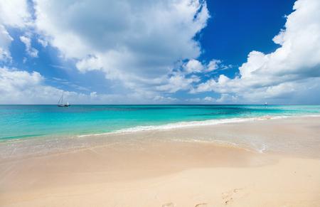 青空: Idyllic tropical beach with white sand, turquoise ocean water and blue sky at Antigua island in Caribbean 写真素材