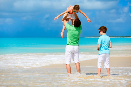 antigua: Father and kids enjoying Caribbean beach vacation on tropical island