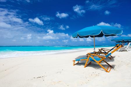 paradise bay: Chairs and umbrella on a beautiful tropical beach at Anguilla, Caribbean