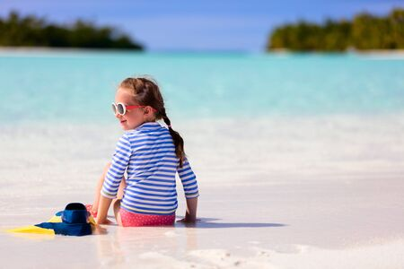 vacation summer: Adorable little girl with snorkeling equipment at beach during summer vacation