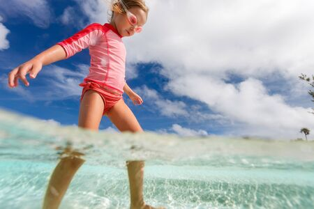 shallow water: Adorable little girl at shallow water on tropical beach
