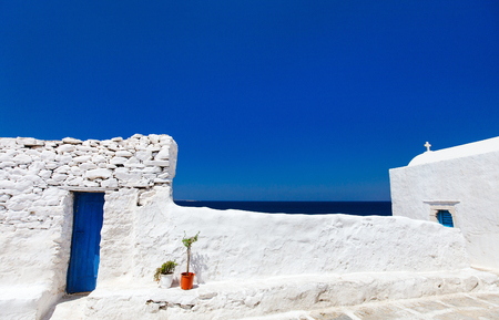 narrow: Typical greek traditional village with white walls and colorful doors on Mykonos Island, Greece, Europe Stock Photo