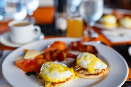 benedict: Delicious breakfast with eggs Benedict, bacon, orange juice and coffee Stock Photo