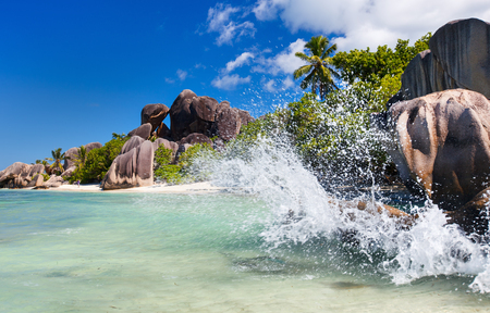 la digue: Beautiful little secluded beach at tropical La Digue island on Seychelles Stock Photo
