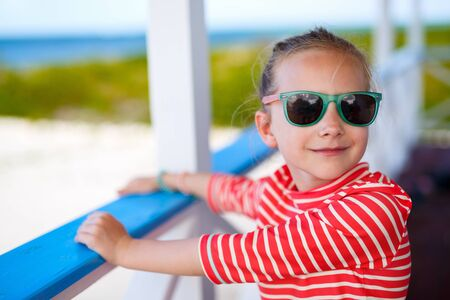 sun glasses: Casual portrait of adorable little girl wearing sun glasses outdoors on summer