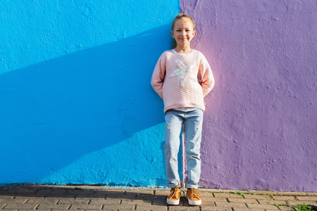 little town: Adorable little girl outdoors against colorful house in Bo Kaap Quarter in Cape Town
