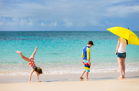 beach landscape: Family mother and kids enjoying tropical beach vacation Stock Photo