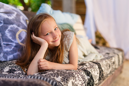 authentic: Casual portrait of adorable little girl Stock Photo